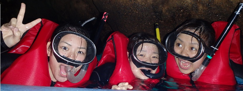 girls snorkeling in blue cave